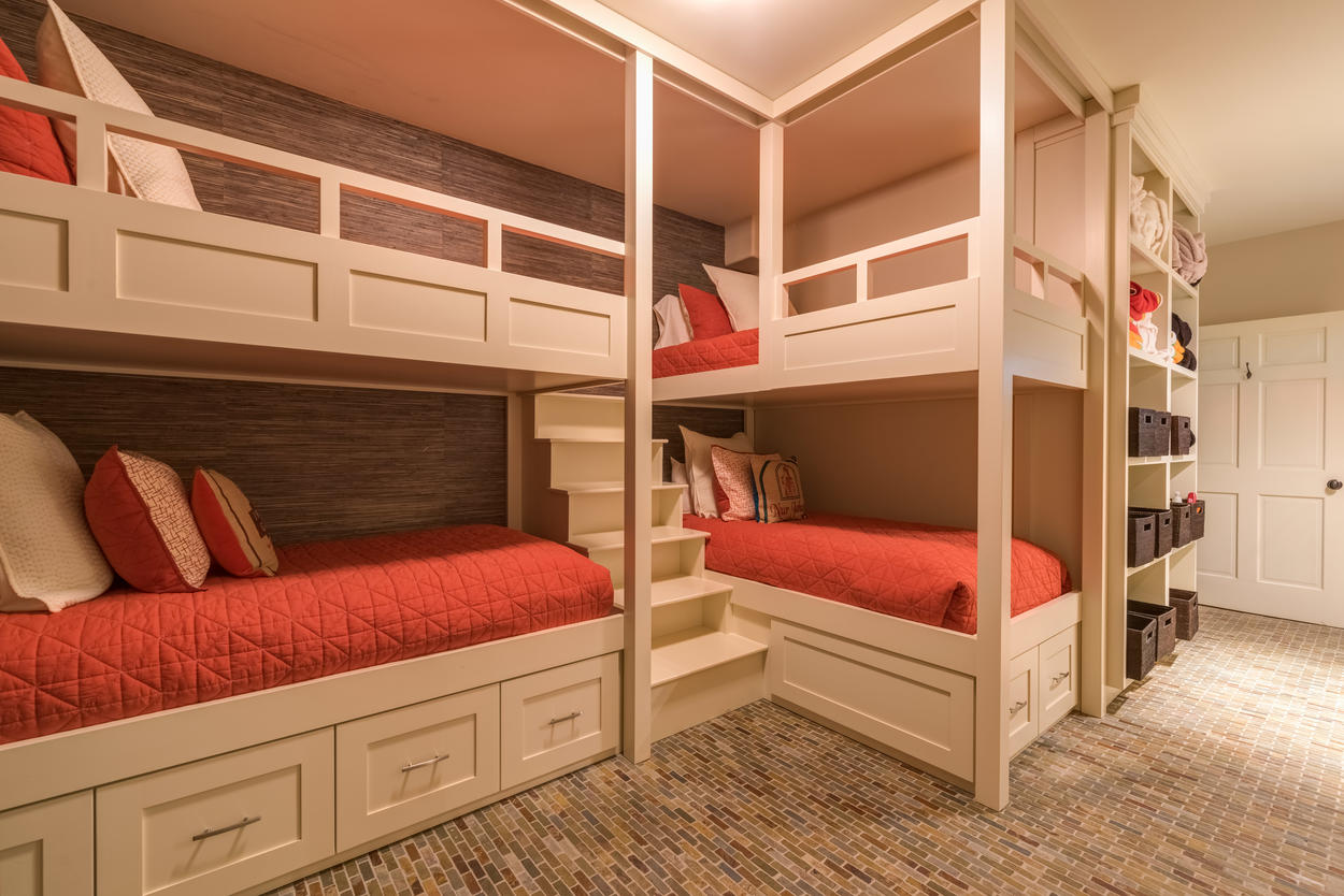 Bunk room cubbies provide plenty of storage for the kids.