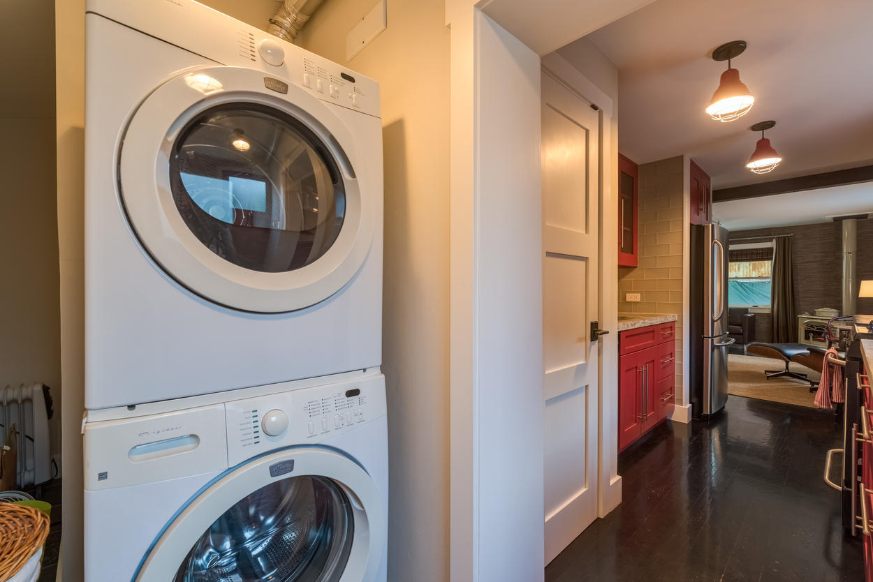 The guest house laundry is located just past the kitchen.