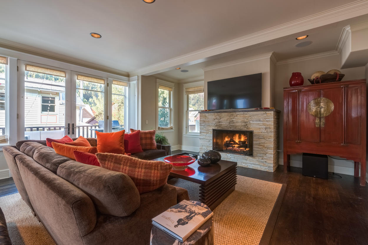 Make yourself at home in the main living area with the cozy seating, fireplace, and flatscreen TV.
