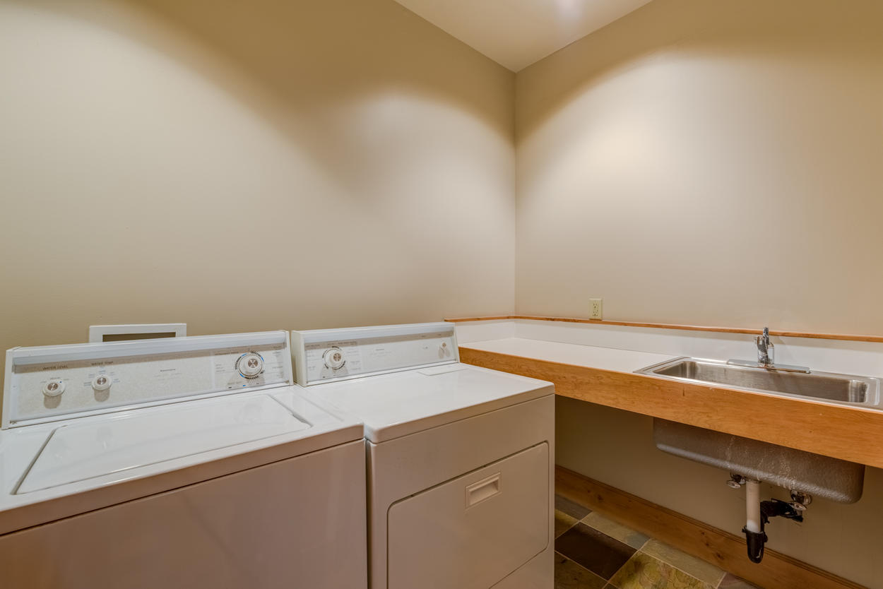 There's a convenient laundry room complete with a washer, dryer, and sink.