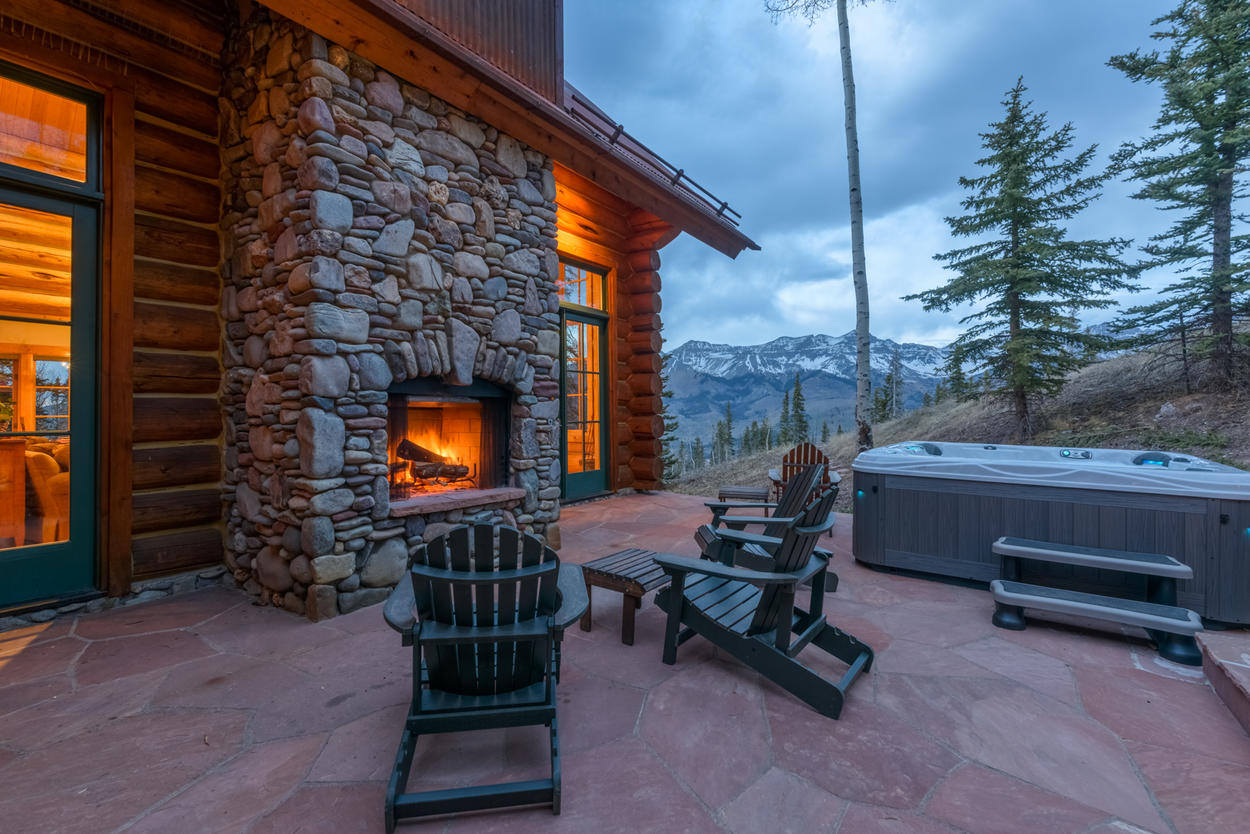 A hot tub with mountain views and an outdoor fireplace under the stars make for the perfect Telluride evening.