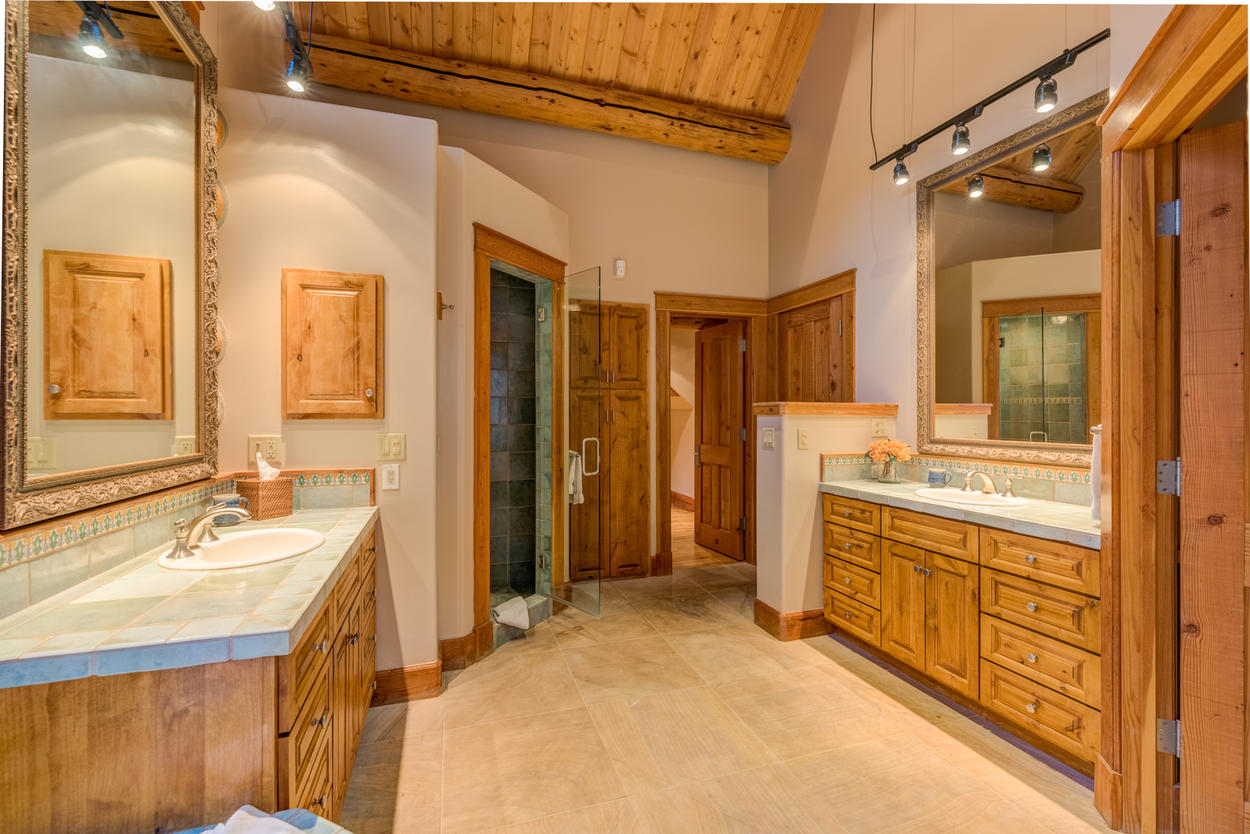 The private ensuite to the master bedroom features dual sinks, a soaking tub and a shower.