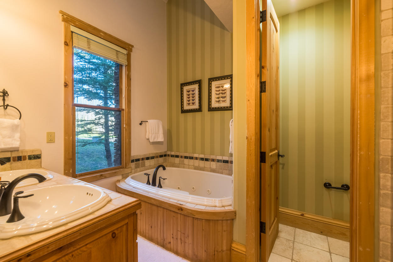 Dual sinks, a soaking tub and a separate shower make the master ensuite a treat for the lucky couple in this room.