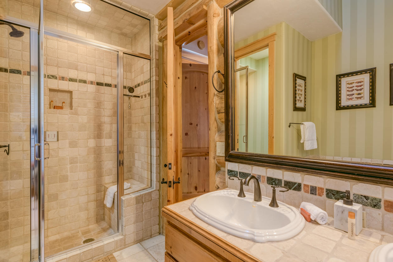 This bathroom is located right off the bedroom.