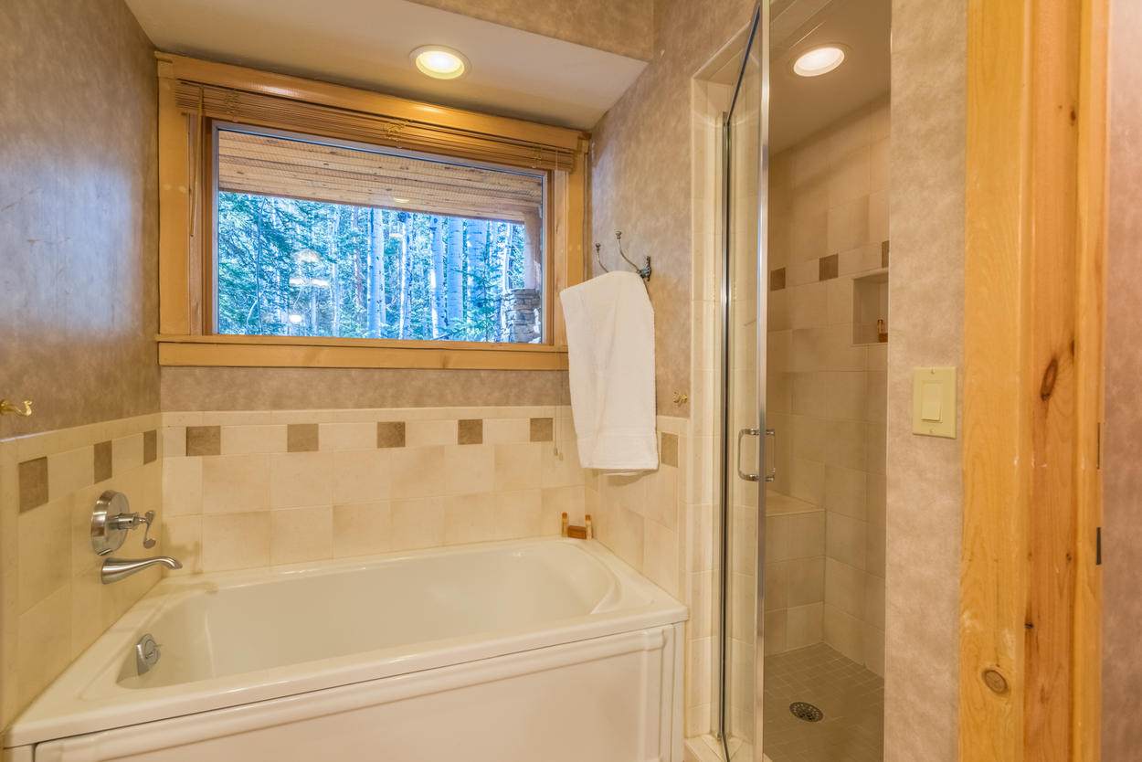 In addition to dual sinks, the bathroom features a soaking tub and stand alone shower.