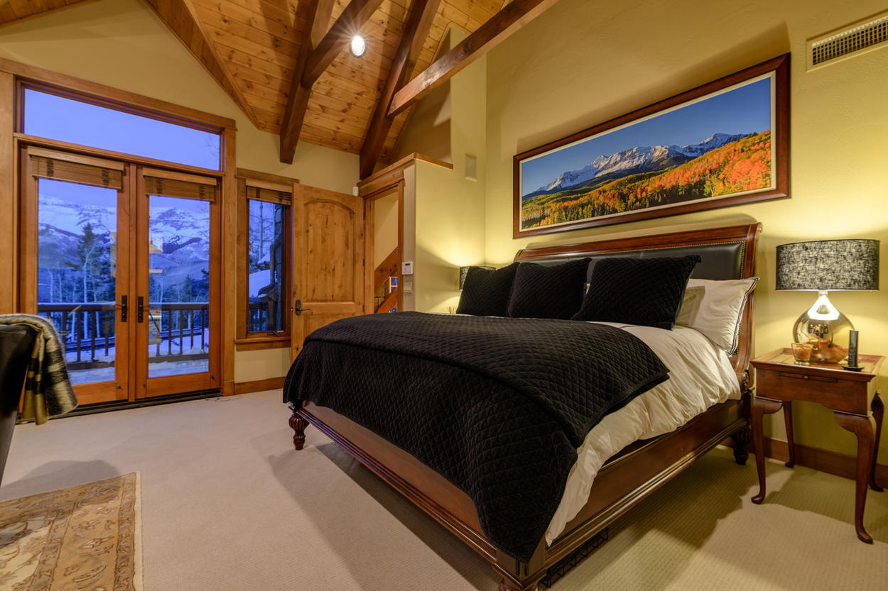 Enjoy private balcony access and mountain views from the King bed in the Master