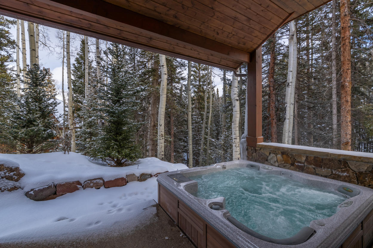 The hot tub is under cover on the lower level patio, so you won't have to worry about stepping through snow to get there