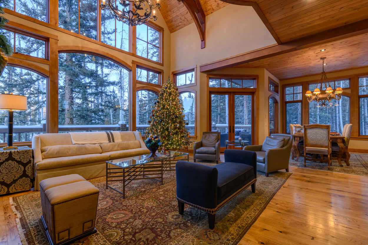 Have a seat on the banquette or settle into a leather armchair in the living room to watch the snow fall outside