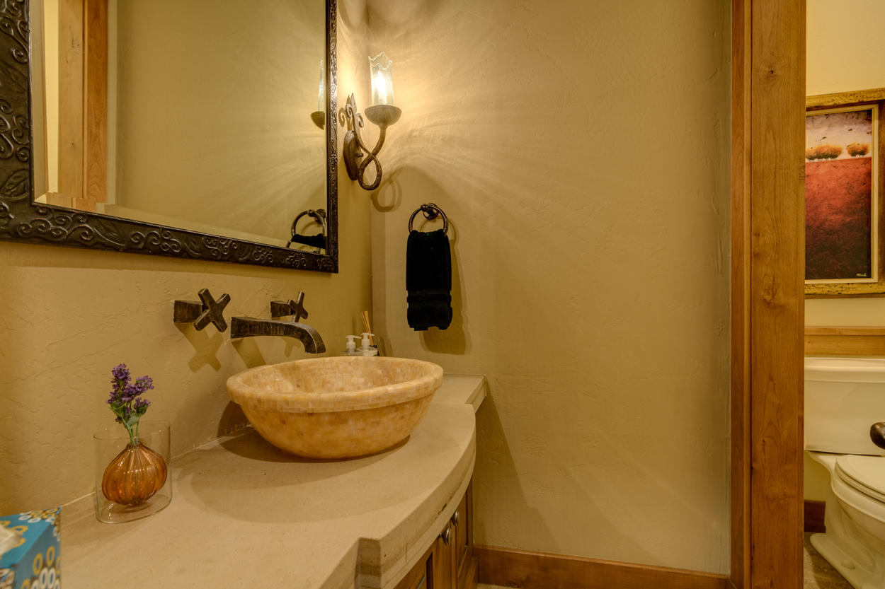 The main living level features a powder room with vessel sink