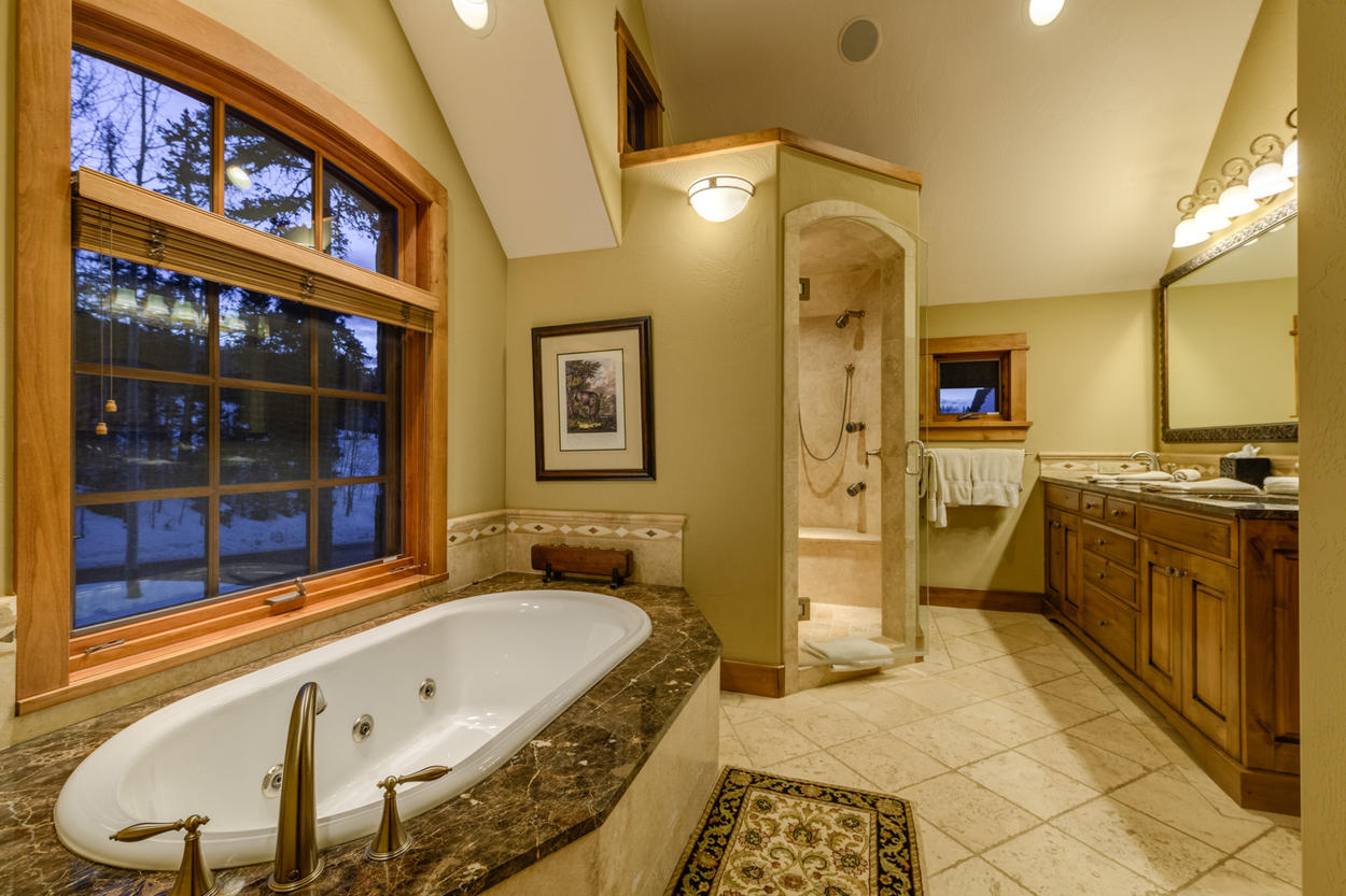 Watch for wildlife as you soak in the jetted tub, or warm up in the steam shower of the Master Bathroom