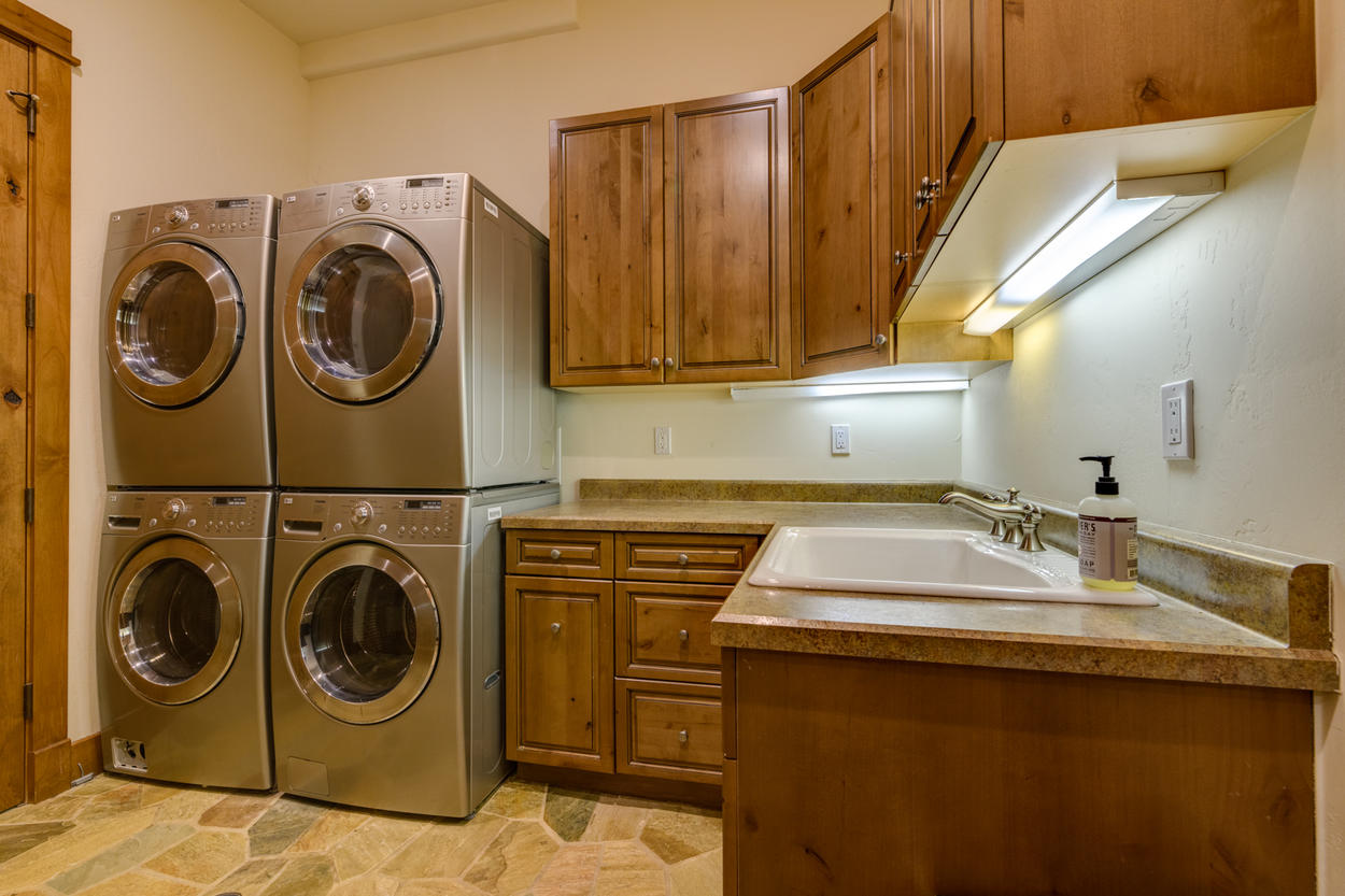 A full laundry room on the lower level holds two sets of washers and dryers to make laundry a breeze