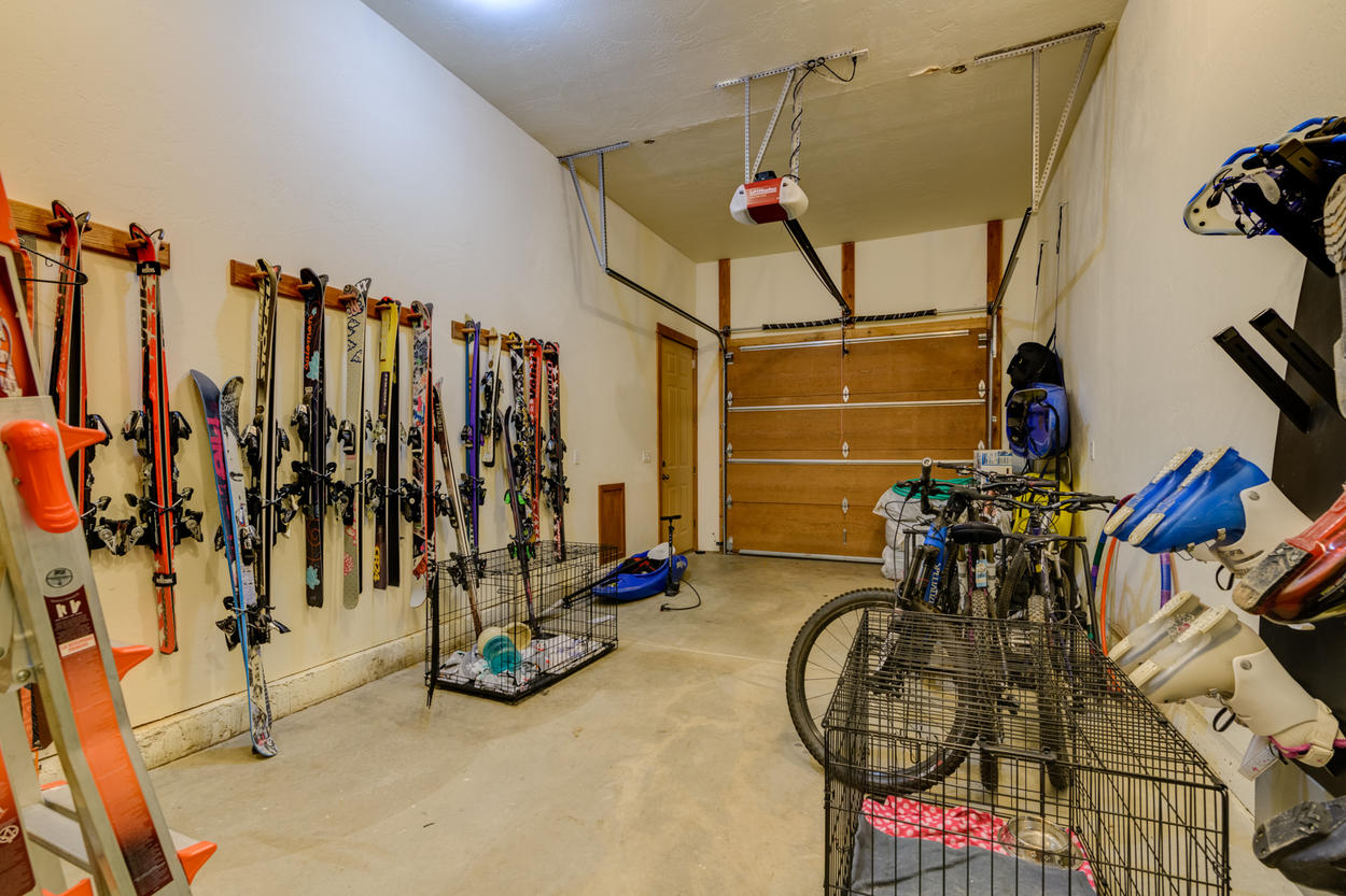 The storage area in the garage has plenty of space for ski and biking equipment.
