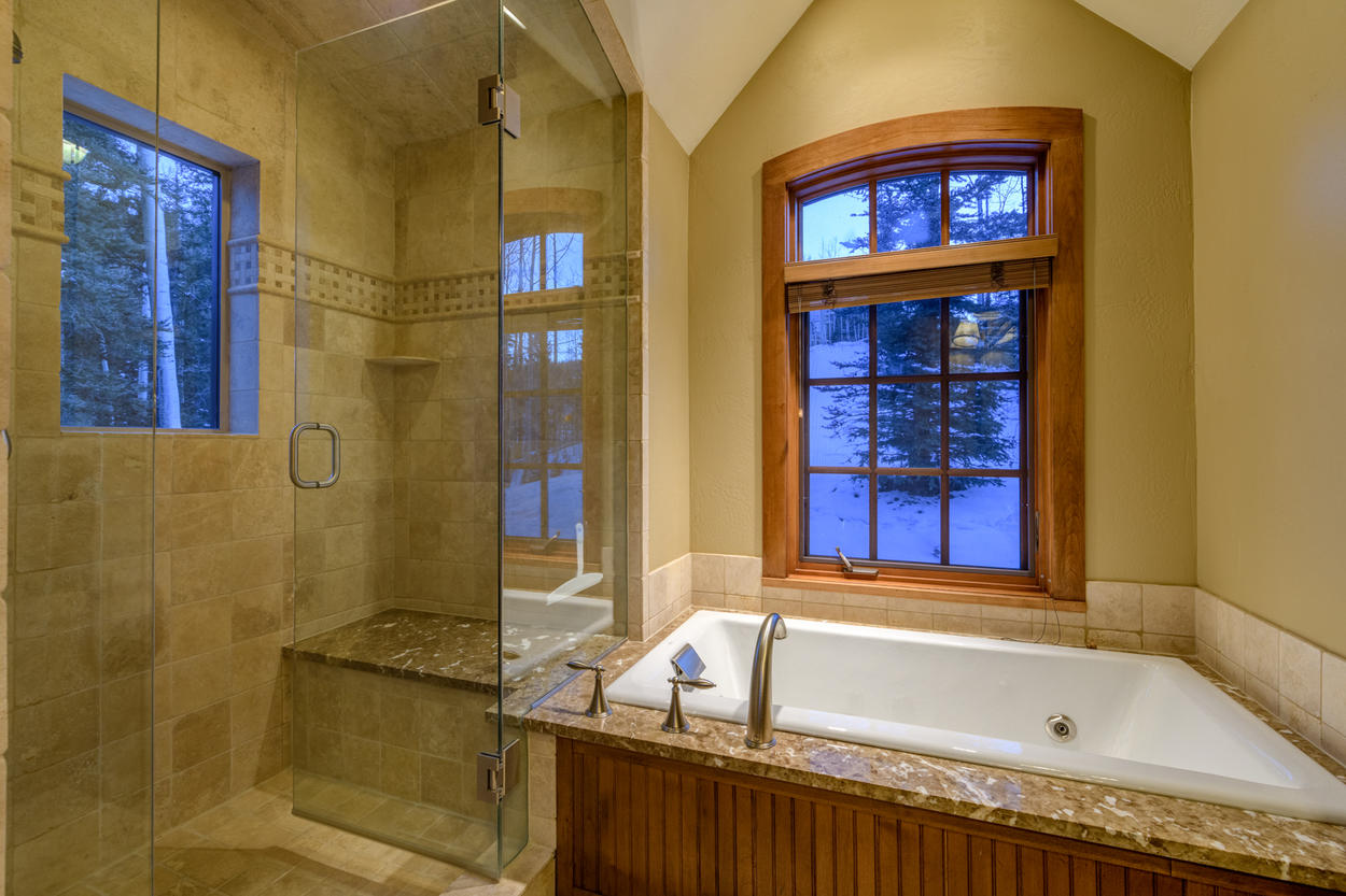 A steam shower accompanies the jetted tub in the Junior Master Ensuite
