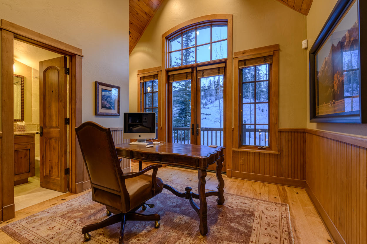 The upper level office has its own views of the mountainside, as well as balcony access.