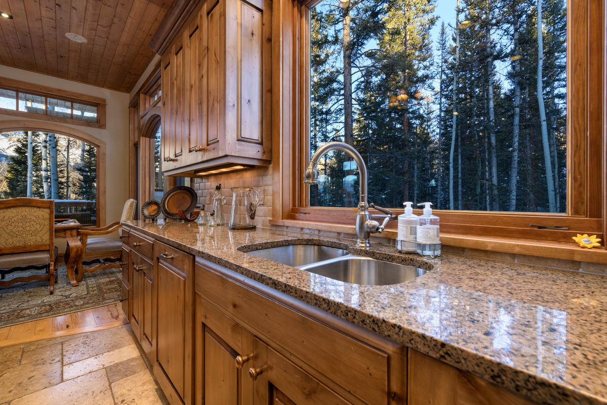 Gaze out at the aspens and pines from behind the smooth granite countertops in the kitchen