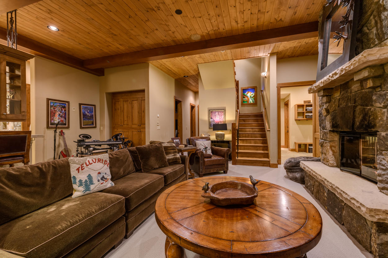 The downstairs den has plenty of seating for family.