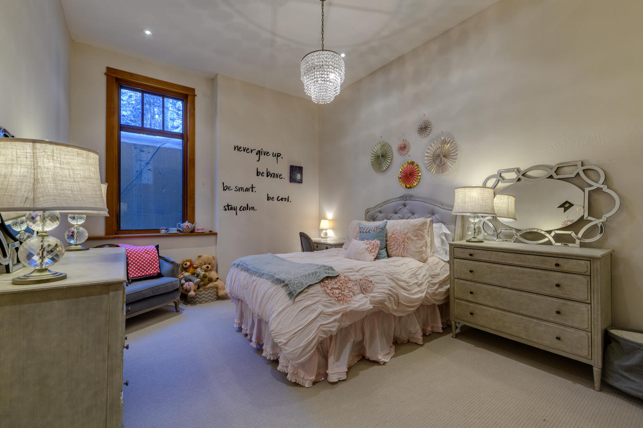 This spacious bedroom is a quiet hideaway from the bustling main living level upstairs