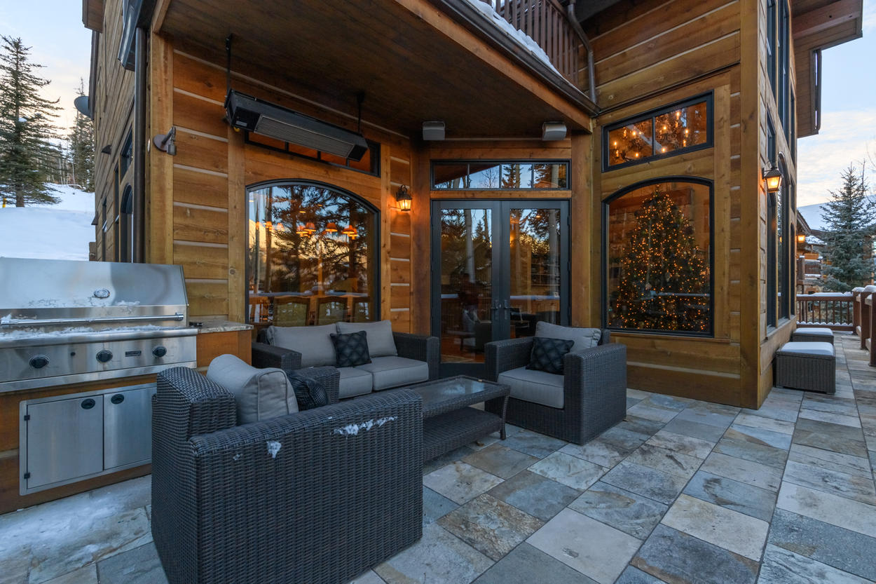 On the main living level, the patio outside has heaters to create all-season enjoyment, and a gas grill