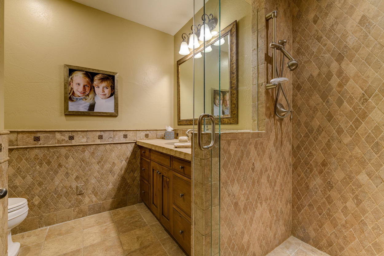 Another spacious bathroom on the lower level of the home is shared between the two bedrooms
