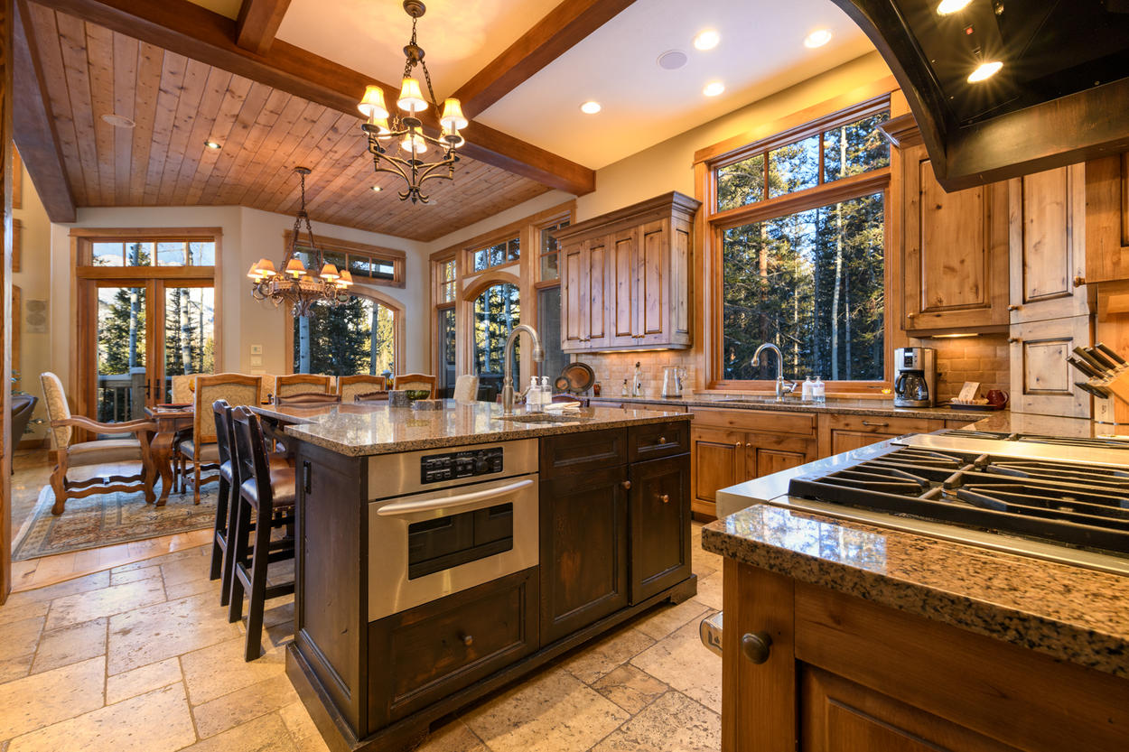 The kitchen is fully-equipped with stainless steel appliances and an abundance of storage space