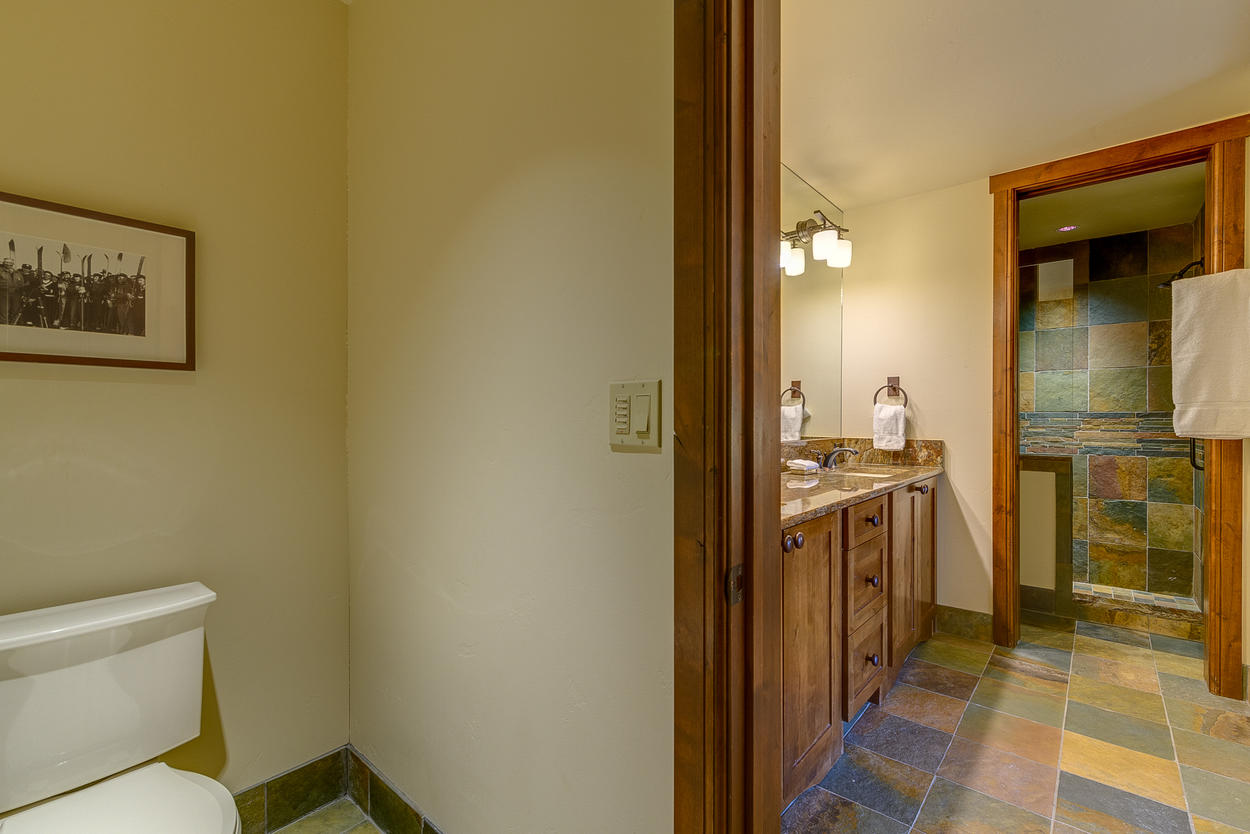 The bunk room's attached ensuite has two sinks and a stand-alone shower.