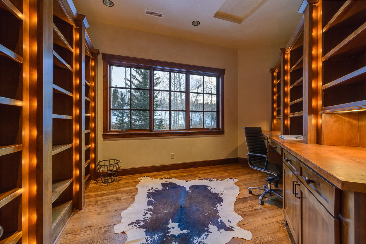 The office is on the top level of the home in a quiet place away from the master suites.