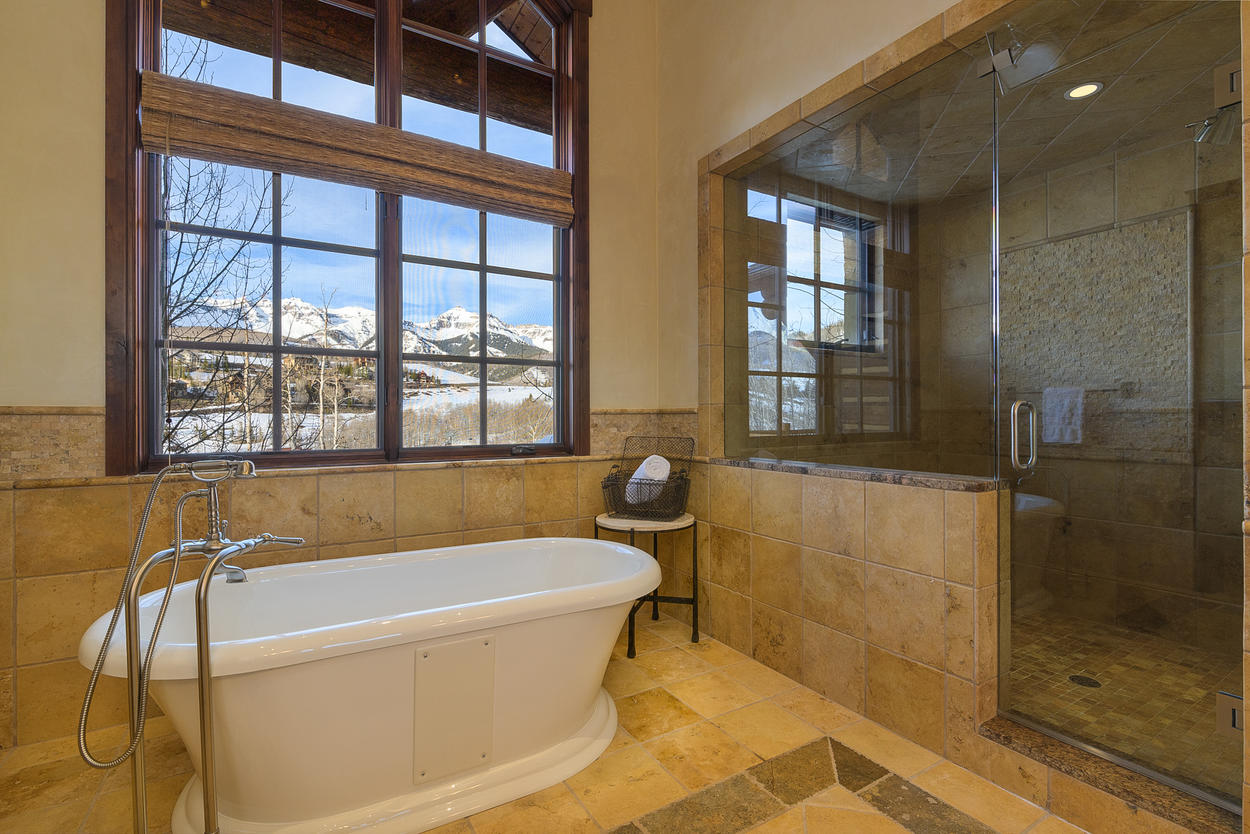 The South Master Suite has an ensuite with a steam shower, jetted tub, two sinks, and a bidet.