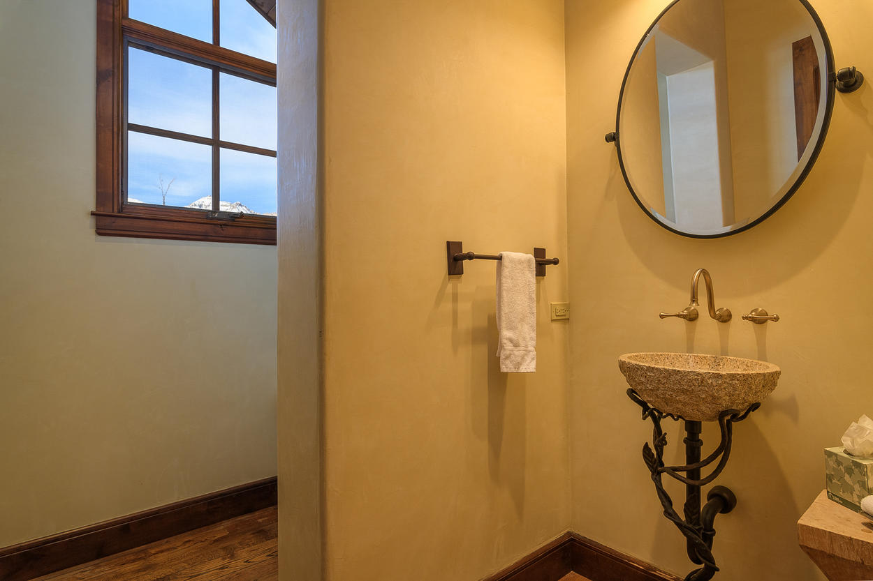 The top level of the main home also has its own shared powder room.