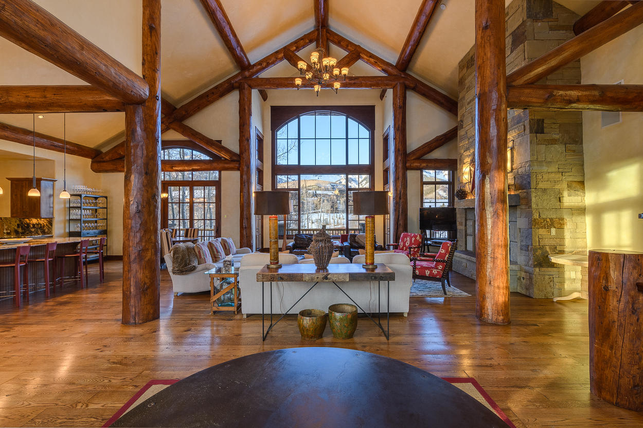 The Great Room features high ceilings and exquisite natural wood designs.