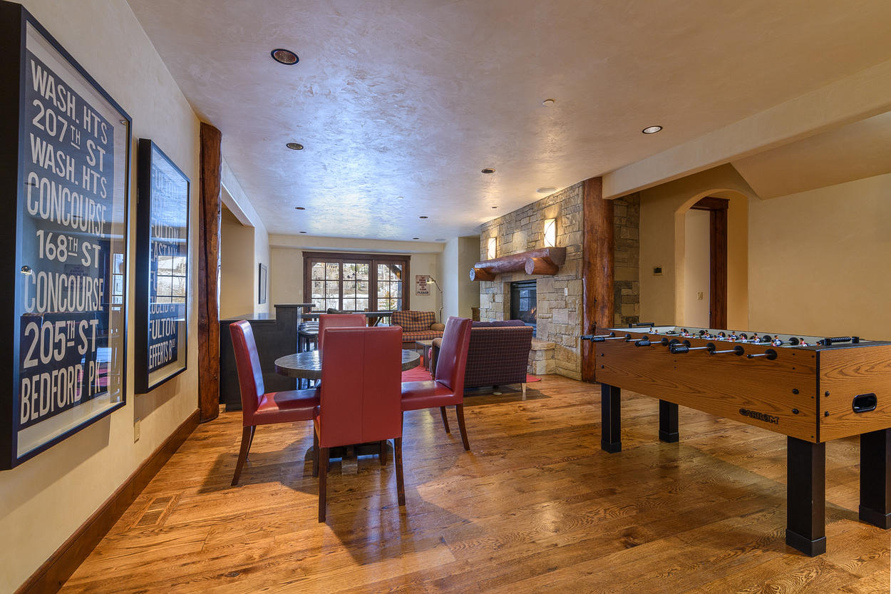 The game room also has a wet bar with a wine fridge, seating for five guests, another TV, and access to another balcony.