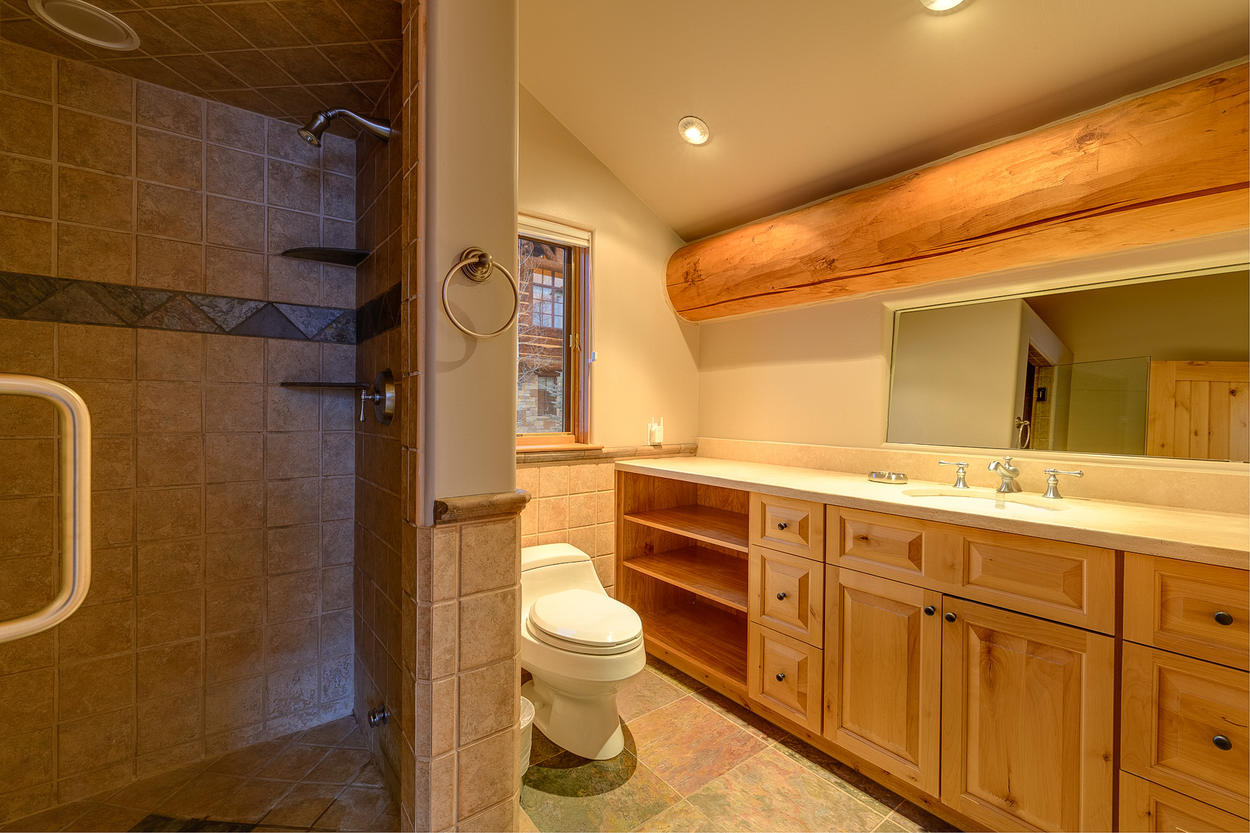 A second shared bathroom on the top level of the guest house has a walk-in shower and single sink.