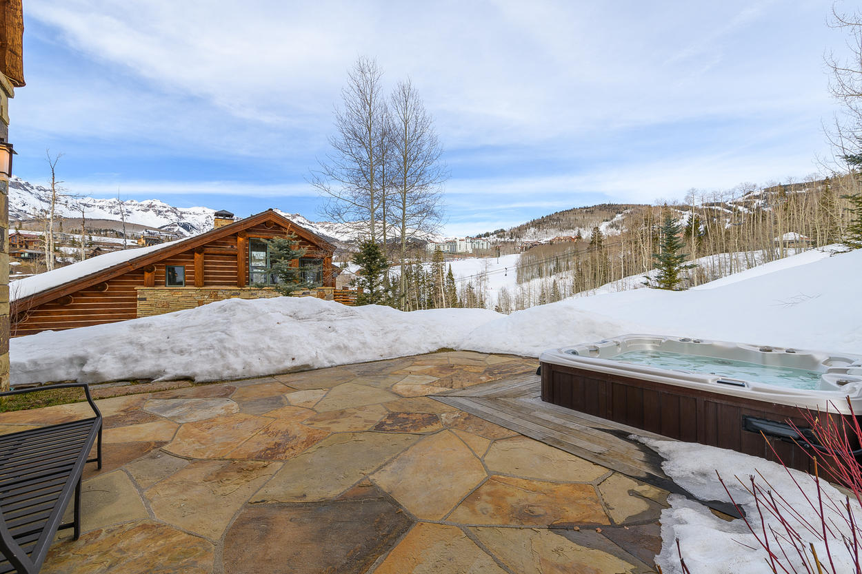 Walk from this patio just a few steps to the ski slopes beyond the hot tub.