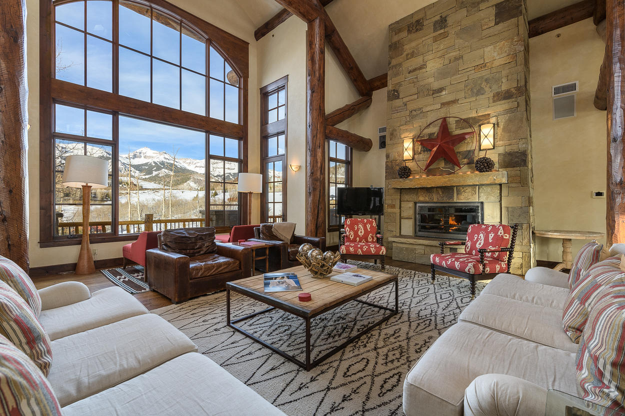 The Great Room's main living area features a gas fireplace, access to the deck, and amazing views.