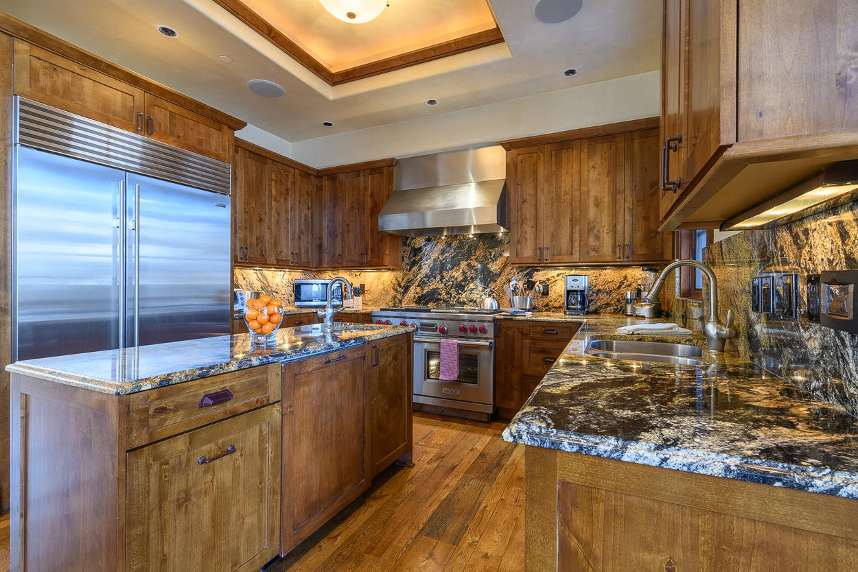The kitchen features a sound system, double oven, and plenty of counter space.