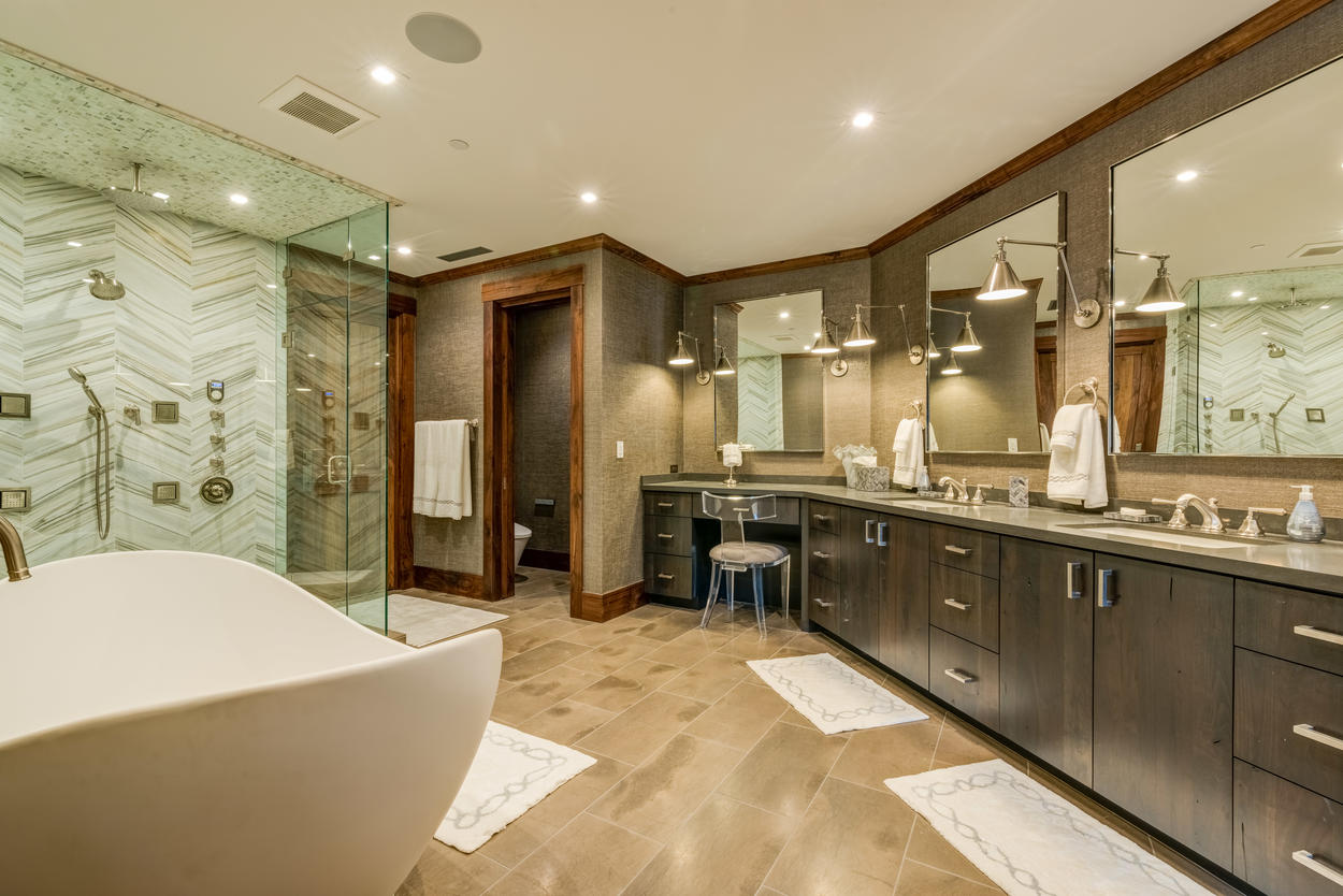 The Master Suite's ensuite bathroom has a soaking tub, steam shower, two vanities, and a sitting counter.