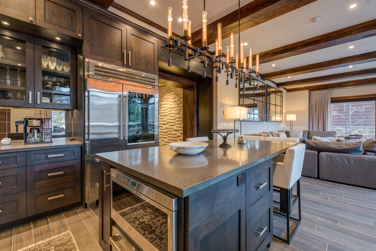 The kitchen is outfitted in modern cabinets and all stainless steel appliances.