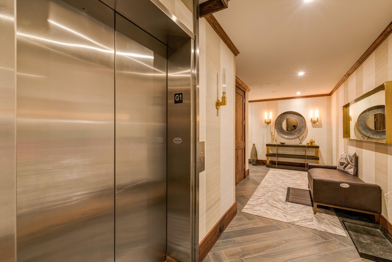Exit the elevator directly into the plush hallway inside of the home.