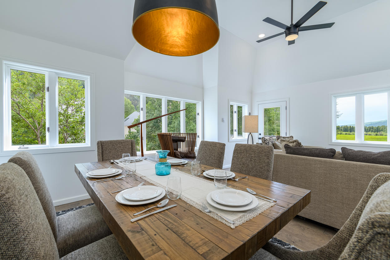 The wooden dining table in the main living area can seat up to six guests.