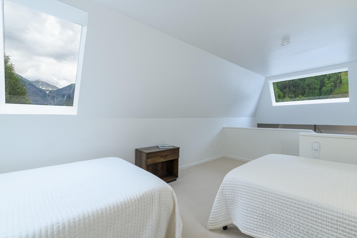 The skylights and windows in the loft bedroom provide excellent vantages of Telluride's most recognizable natural features.
