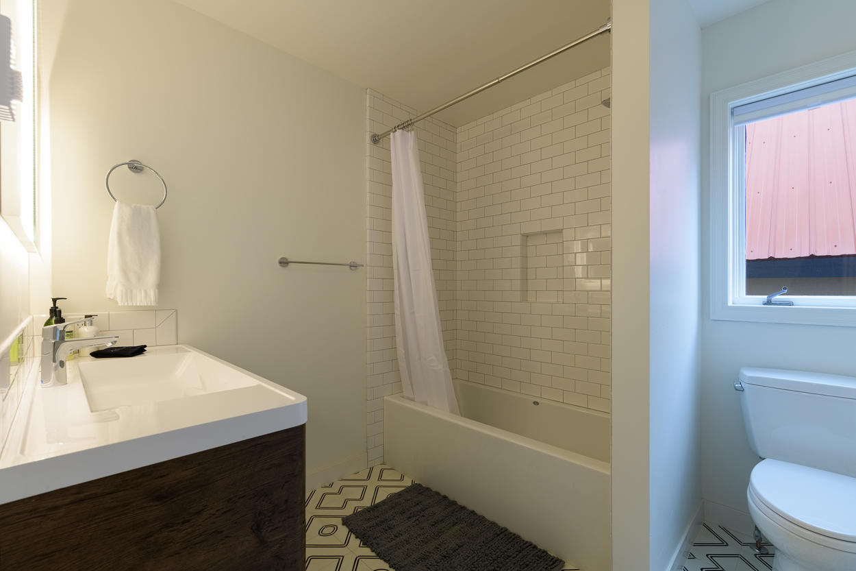 A shared bathroom on the second floor features a shower/tub combination and large sink.
