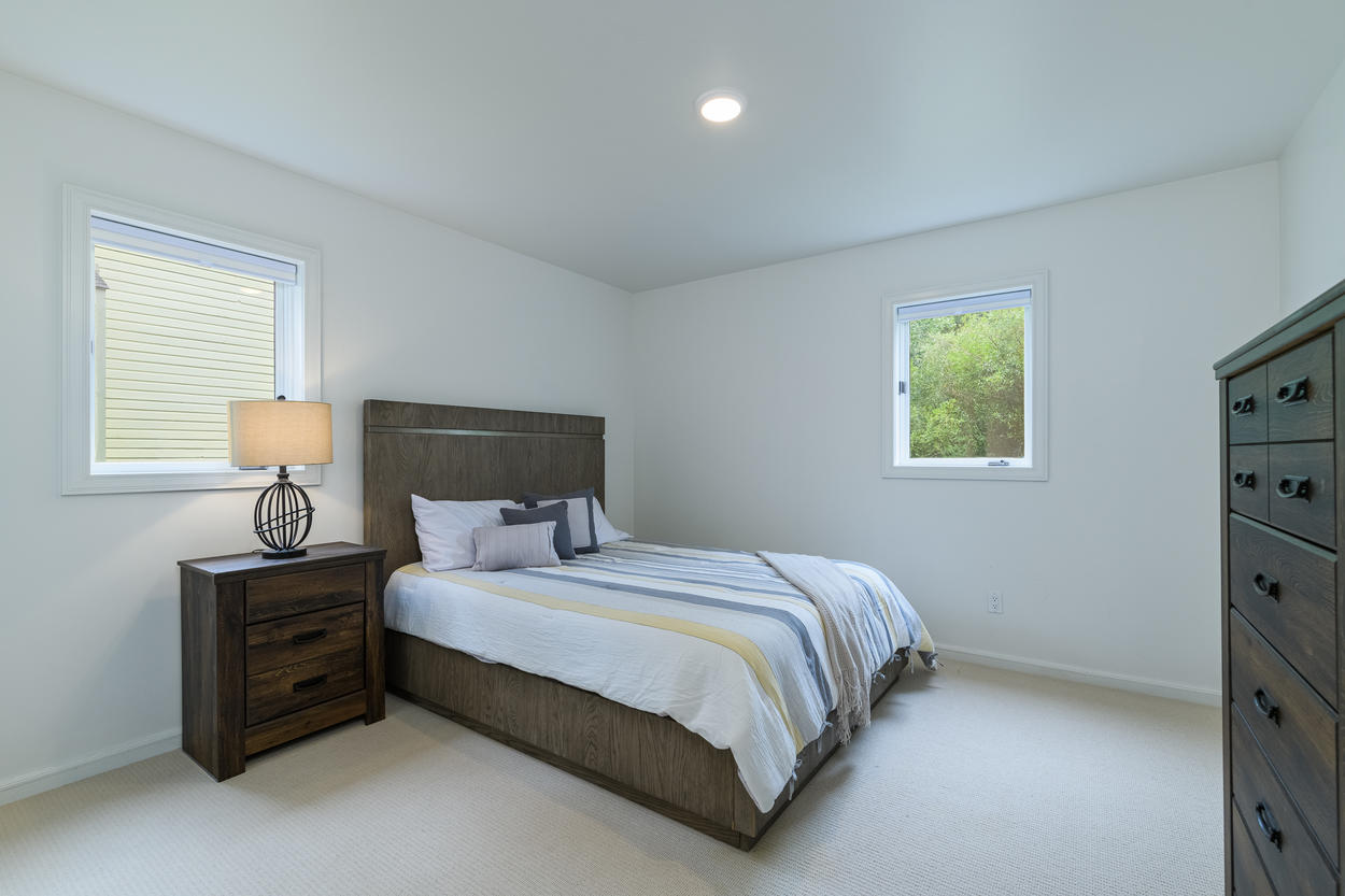 The Queen Bedroom is in a quiet corner of the home's lower level.