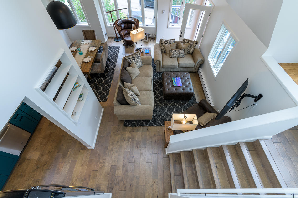 The high ceilings and large windows keep the main floor open and bright.