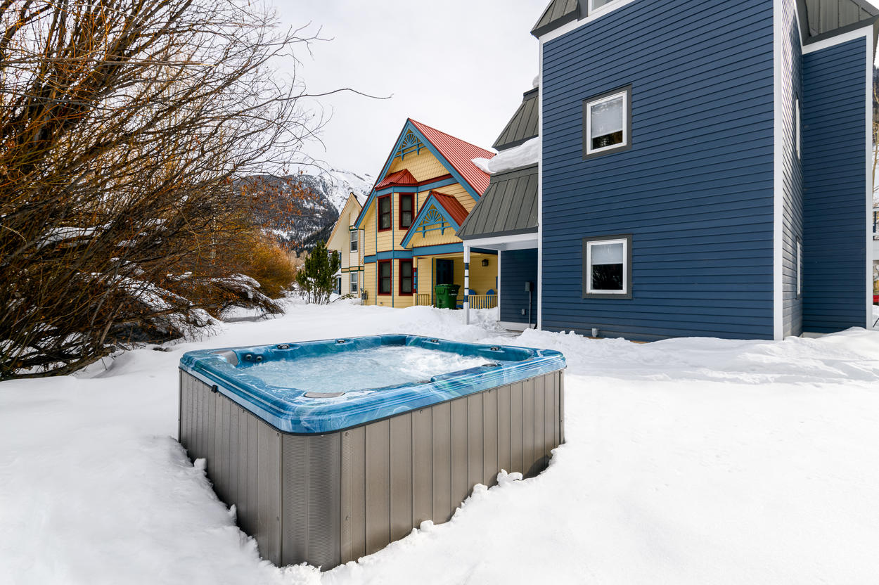 The hot tub is located behind the home and comfortably seats 8