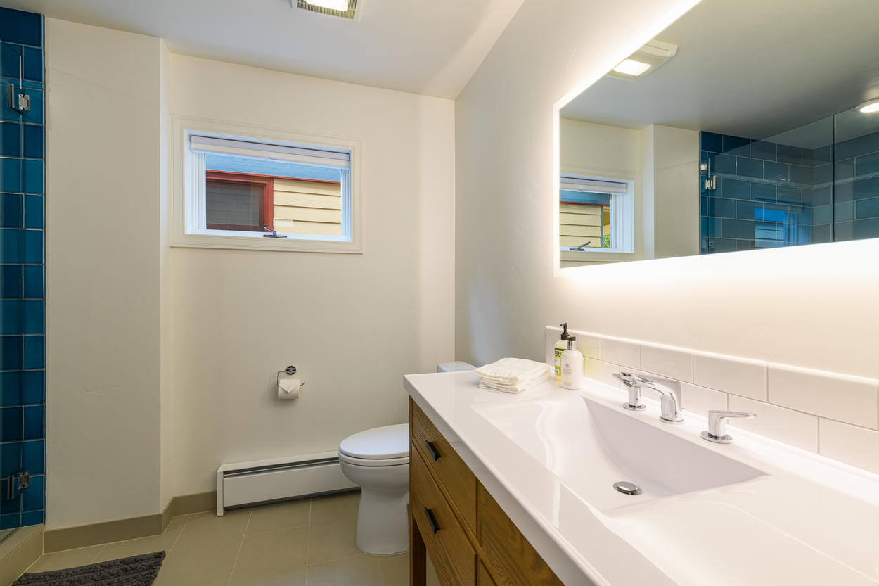 The first floor full bathroom is located in the hallway near the King and Queen Bedrooms.