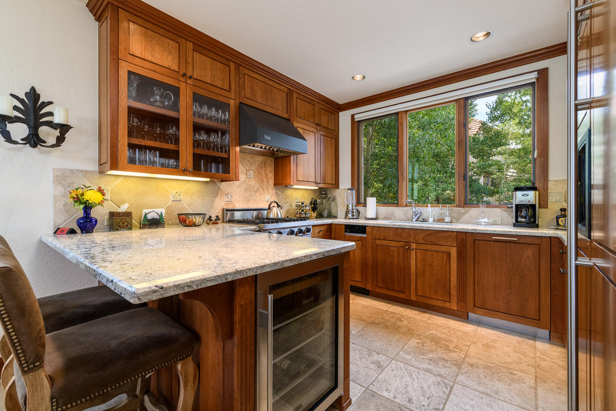 The kitchen has a breakfast bar with additional seating for two.