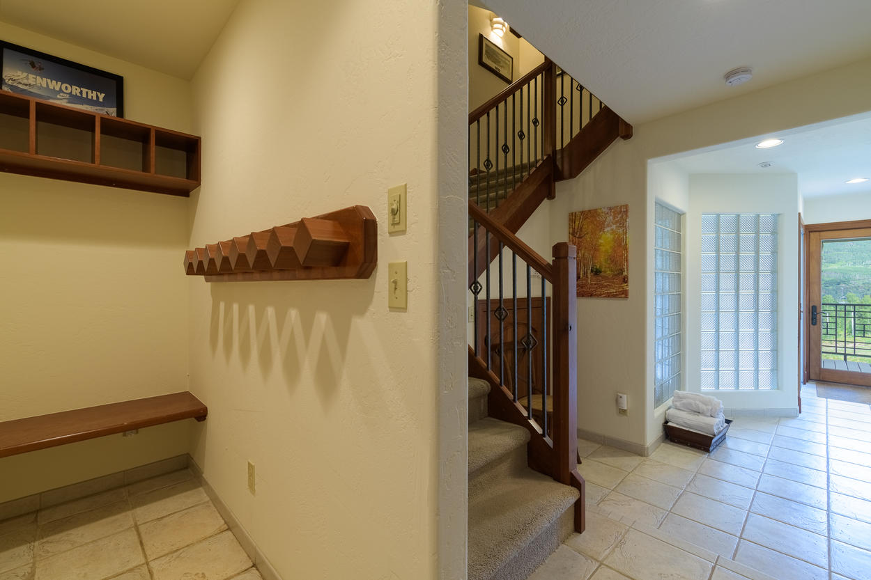 On the first floor, you'll find access to the lower deck, indoor hot tub and sauna, and the gear storage area.