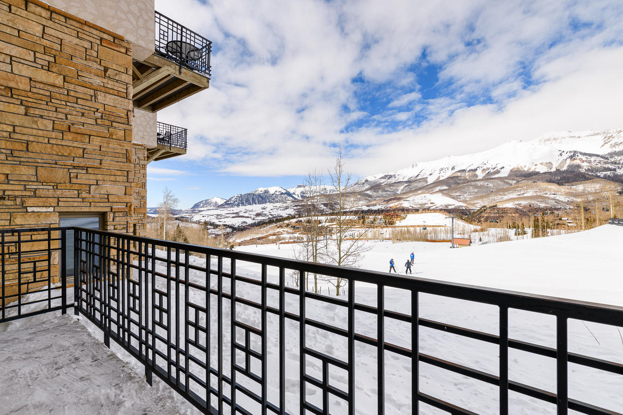 Relax on your lower deck and admire the iconic landscape of Mountain Village.