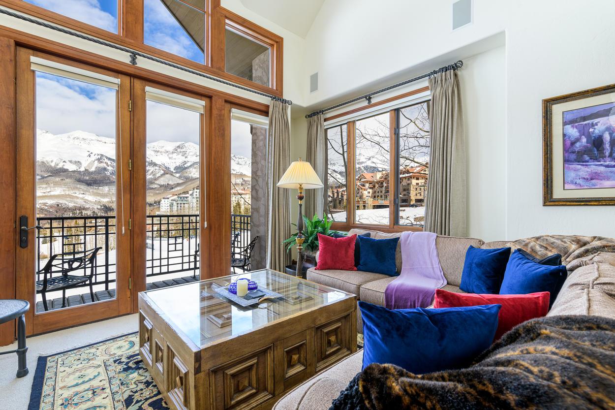 The living room has stunning views of the San Sophia Ridge.