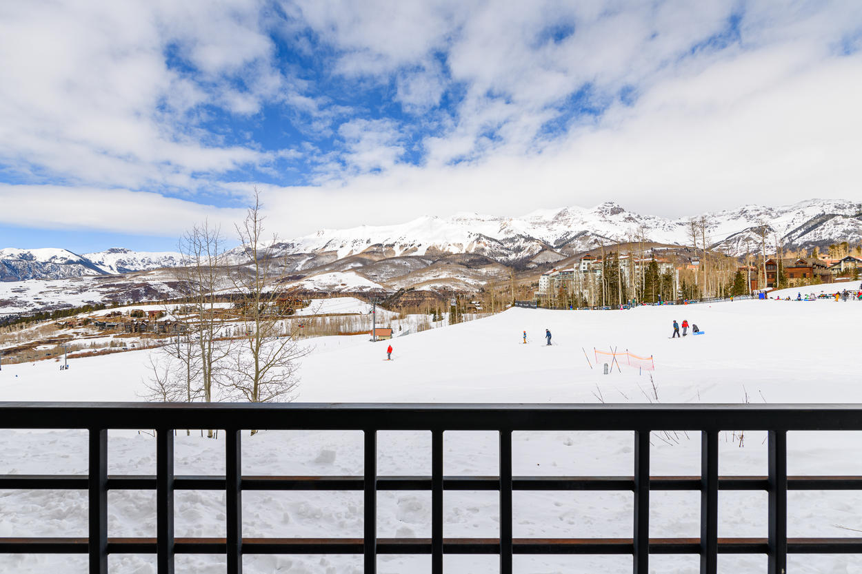 Watch the passing skiers and snowboarders from the balcony
