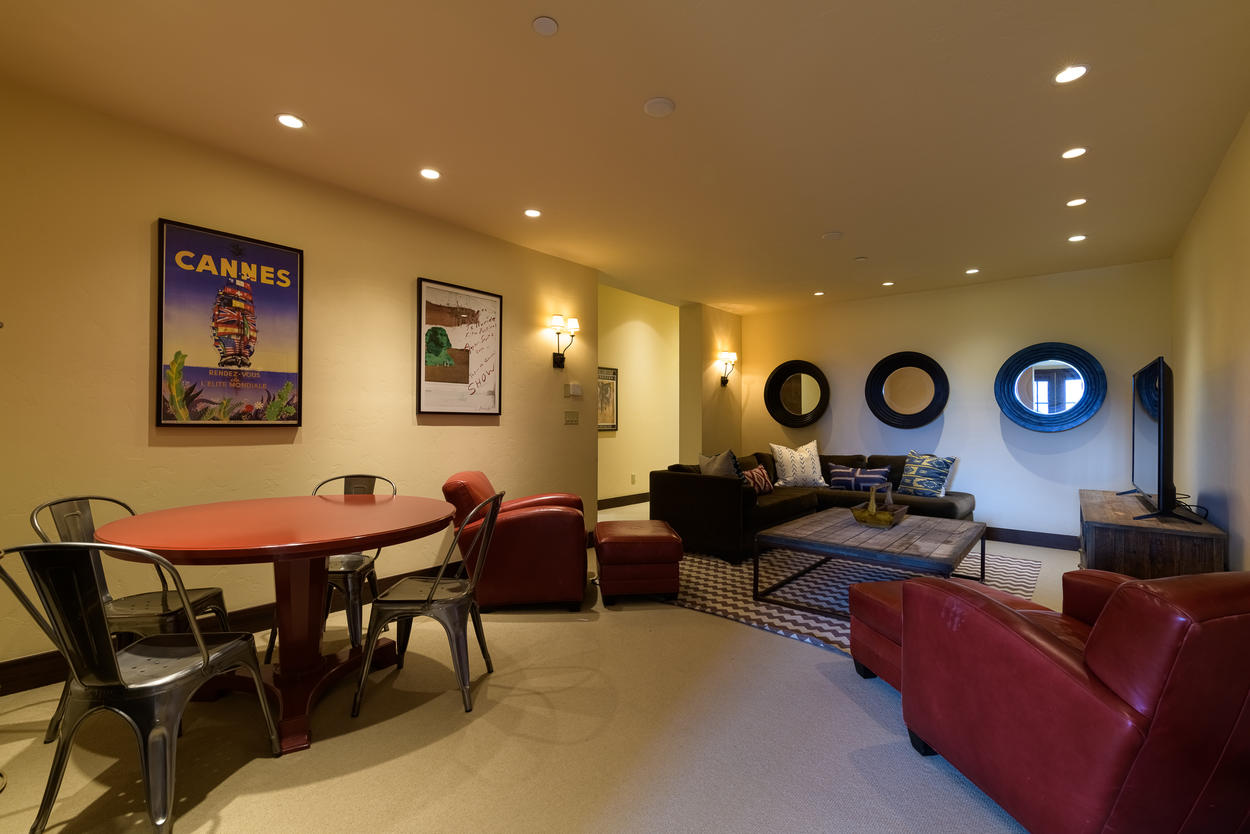 The media room features a card table perfect family games.
